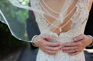 woman wearing beige bridal gown during day time